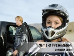 Putting motocross racer helmet