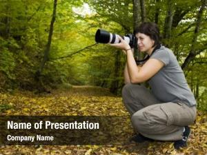 Photographer young female autumn forest