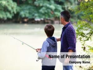 Fishing father son river bank,