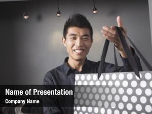 Holding store clerk shopping bag