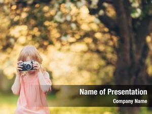 Retro little photographer camera outdoors