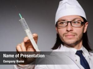 Man young doctor syringe against