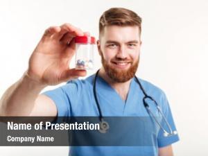 Doctor portrait smiling holding bottle