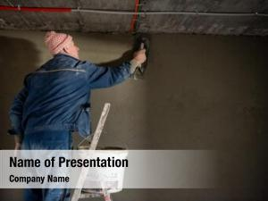 Plastering construction worker interior wall