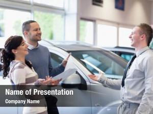 Salesman couple chatting car shop