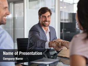 During businessman handshake meeting, signing