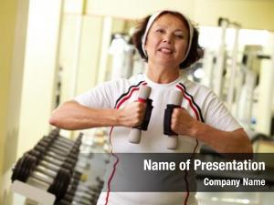 Woman persistent elder dumbbells keeping