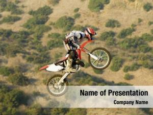 Racer freestyle motocross performing stunt