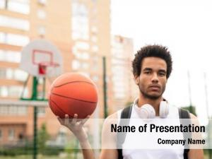 Active young serious male basketballer