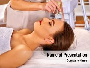 Receiving young woman electroporation facial