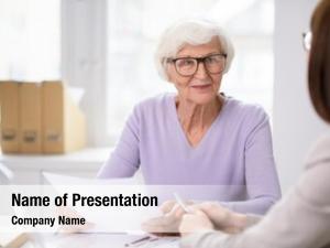 Female senior smiling client insurance