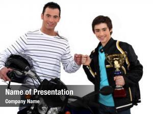 Son father congratulating motocross victory