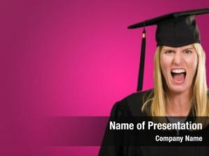 Woman angry graduate against pink
