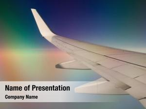 Wing commercial airplane rainbow colors