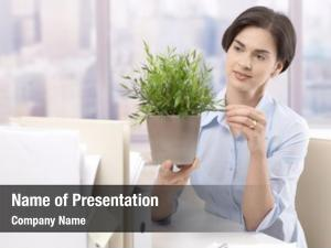 Worker female office holding potted
