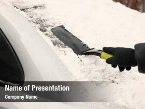Snow man removing car scraper