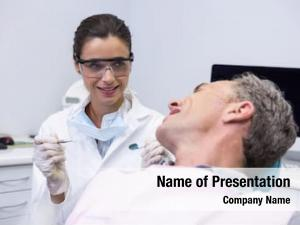 Holding happy dentist