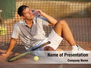 Tennis exhausted male player sitting