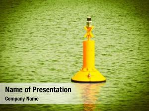 Floating yellow buoy sea waves