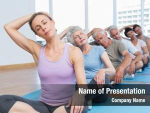 Class female trainer stretching neck