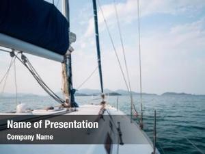 Anchored sailing vessels calm bay