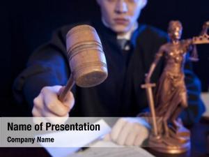 Courtroom male judge striking gavel
