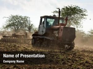 Cultivating agricultural tractor land
