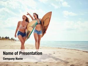 Women's happy surfer bikini surfing