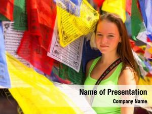 Buddhist young girl prayer flags