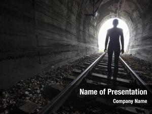 Tunnel man silhouetted standing center