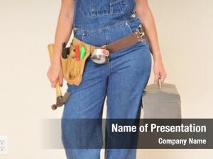 Handyman closeup female overalls tool