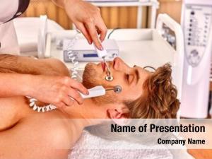 Electric man receiving galvanic facial