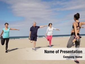 Exercising senior people beach sports