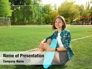 Football field hipster girl with skateboard