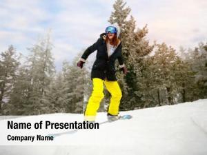 Smiling girl snowboarder