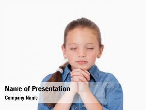 Praying little girl against white