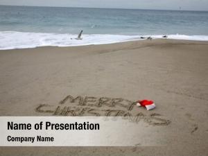 Christmas words merry written sand