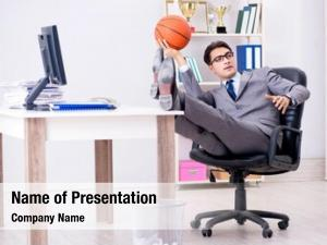 Basketball playing young businessman
