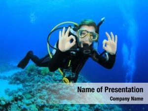 Diving woman scuba signals okay