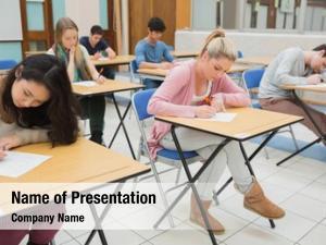 Classroom people sitting writing writing