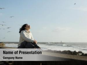 Woman beautiful asian sits waterfront