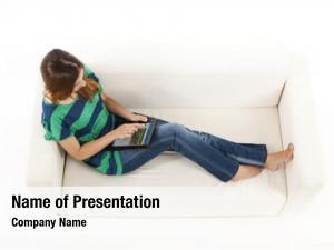 Sofa girl sitting using tablet
