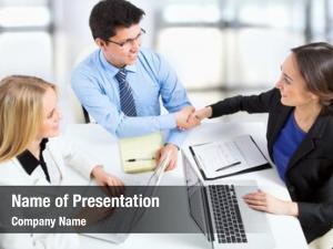 Business friendly handshake meeting office