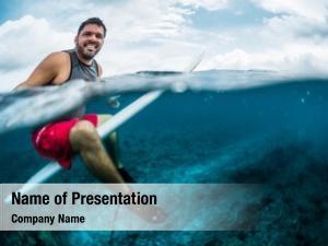Looking at camera happy surfer waits