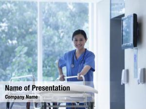 Empty nurse wheeling stretcher halls