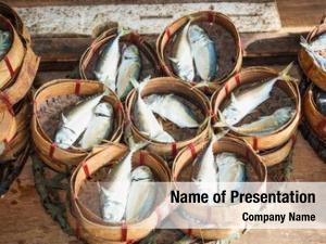 Fisherman mackerel fish in bamboo