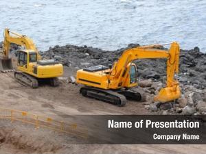 Excavators two orange near sea