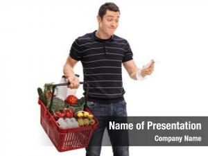 Holding displeased guy shopping basket