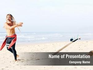 Shirtless young adult surfer dreadlocks