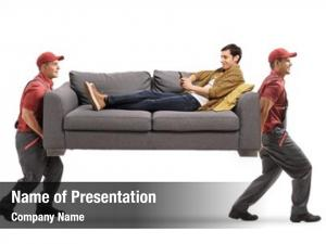 Sofa movers carrying man sitting
